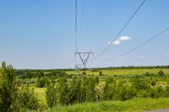 High-voltage power line against the blue sky royalty free stock photo