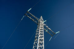High-voltage power line against blue sky Stock Photography