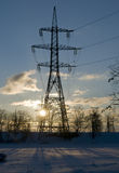 High-voltage power line against winter landscape Stock Photography