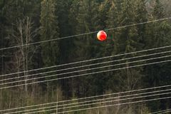 High voltage power line with big ball for warning pilots, low fl. Ying aircraft and helecopter Royalty Free Stock Images