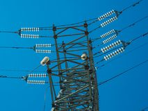 High voltage power line on blue sky background in Sunny day. Close-up stock image