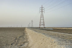 High voltage power line in desert Royalty Free Stock Image