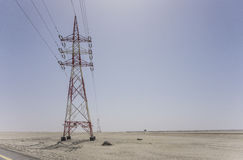 High voltage power line in desert Royalty Free Stock Photos