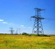 High voltage power line in the field Royalty Free Stock Photography
