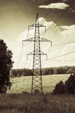 High-voltage power line in the field Stock Photography