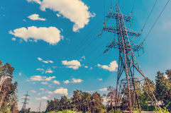 High-voltage power line in the field. Toned image stock photo