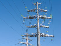 High-voltage power line grey metal props. On blue sky Royalty Free Stock Images