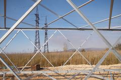 High-voltage power line in an industrial suburb. Installation of support for power lines royalty free stock photo