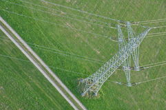 High voltage power line. Mast in meadow - from bird's eye view Stock Photos