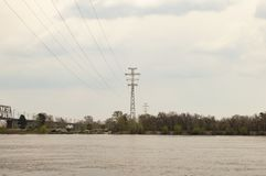 High-voltage power line over the river royalty free stock images
