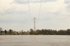 High-voltage power line over the river stock photo
