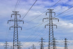 High voltage power line poles Royalty Free Stock Image