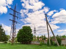 High voltage power line and sky. High voltage electricity pylon and transmission power line on the blue sky and white clouds on the background Stock Image