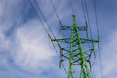High voltage power line stand coopyspace. Blue sky green stand power line Stock Photo