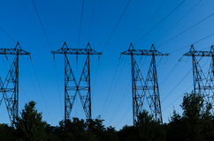High-voltage power line. Supports of high-voltage power lines against the blue sky Royalty Free Stock Photos