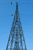 High-voltage power line. Supports of high-voltage power lines against the blue sky Stock Photos
