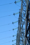 High-voltage power line. Supports of high-voltage power lines against the blue sky Stock Photo