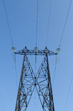 High-voltage power line. Supports of high-voltage power lines against the blue sky Royalty Free Stock Photography