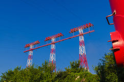 High-voltage power line. Supports of high-voltage power lines against the blue sky Stock Image