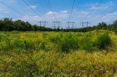 High-voltage power line. Supports of high-voltage power lines against the blue sky Stock Images