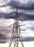 High voltage power line before a thunder-storm, Transmission line. Electricity, industry, technology, power, power-line, high voltage power lines and pylon Royalty Free Stock Photo