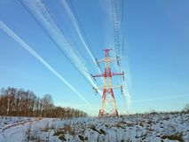 High voltage power line tower in a background of blue sky. Royalty Free Stock Images
