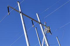 High voltage power line tower crane lineman Royalty Free Stock Images