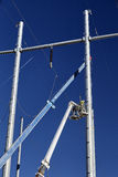 High voltage power line tower crane workers men and jet Stock Photography