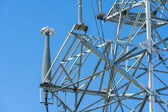 High voltage power line tower sky closeup.  stock images