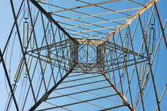High voltage power line. Tower of a power line viewed from inside Royalty Free Stock Photo
