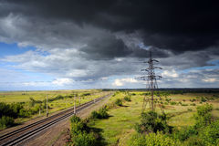 High voltage power line under gloomy sky. Royalty Free Stock Image