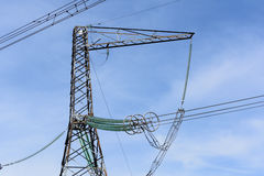 High-voltage power lines. High-voltage power lines against the blue sky Royalty Free Stock Photo
