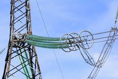 High-voltage power lines. High-voltage power lines against the blue sky Stock Photography