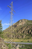 High voltage power lines in Altai Mountains near Stock Image
