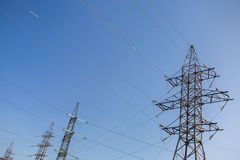 High voltage power lines. On blue sky background royalty free stock images