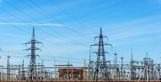 High voltage power lines at blue sky. electricity distribution station. high vol Royalty Free Stock Photography