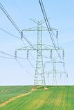 High voltage power lines and countryside Royalty Free Stock Photography