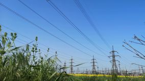 High-voltage power lines. electricity distribution station. Electricity distribution station. high-voltage power lines. Beautiful view of nature and man-made stock video footage