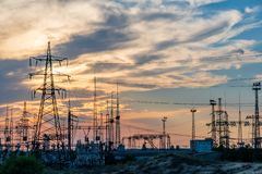High-voltage power lines. Electricity distribution station. high. Voltage electric transmission tower. Distribution electric substation with power lines and stock image