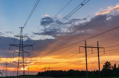 High-voltage power lines. Electricity distribution station. high voltage electric transmission tower. Distribution electric royalty free stock photography