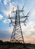 High-voltage power lines. Electricity distribution station. high voltage electric transmission tower. Distribution electric. Substation with power lines and royalty free stock photography