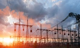 High-voltage power lines. Electricity distribution station. high voltage electric transmission tower. Distribution electric. Substation with power lines and stock photo