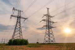 High-voltage power lines. Electricity distribution station. hig. H voltage electric transmission tower. Distribution electric substation with power lines and stock images