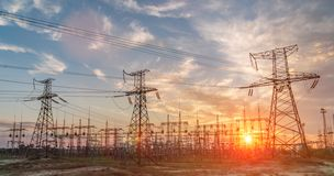 High-voltage power lines. Electricity distribution station. high voltage electric transmission tower. Distribution electric. Substation with power lines and royalty free stock image