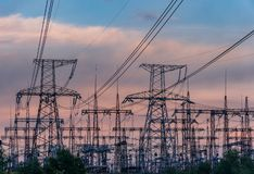 High-voltage power lines. Electricity distribution station. high voltage electric transmission tower. Distribution electric. Substation with power lines and royalty free stock images
