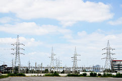 High voltage power lines with electricity pylons at blue sky. Stock Photography