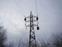 High-voltage power lines in a gloomy sky background. Ecological problems stock photography