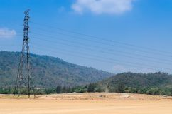High voltage power lines. High voltage power lines electric pole in nature Royalty Free Stock Photos