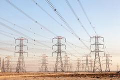 High voltage power lines. In Kuwait, Middle East Stock Photo