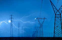 High voltage power lines. And lightning Royalty Free Stock Photography